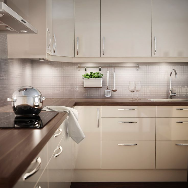 IKEA FAKTUM kitchen with ABSTRAKT yellow-white high-gloss doors/drawers and PRÄGEL walnut effect worktop