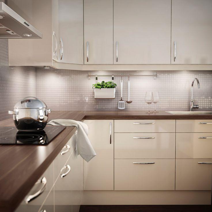 IKEA FAKTUM kitchen with ABSTRAKT yellow-white high-gloss doors/drawers and PRÄGEL walnut effect worktop