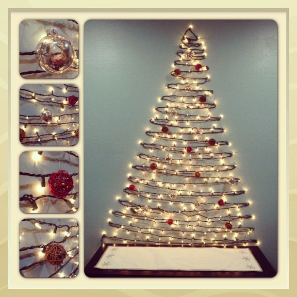 Christmas tree on the wall. Ornaments are mercury glass and those decoration balls you can buy at target. Talk about fun decorating on a budget!