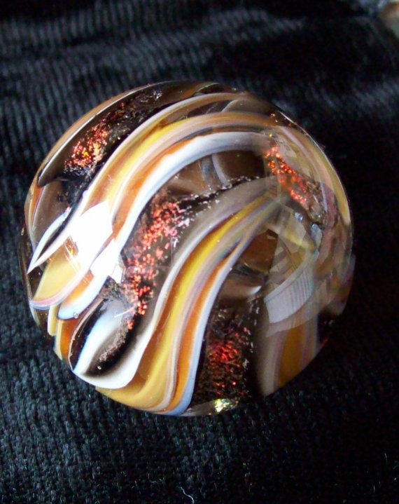 joseph crisanti  http://www.etsy.com/listing/96367494/art-glass-marble-dichroic-swirl-2011?ref=sr_gallery_44_search_query=marbles_view_type=gallery_ship_to=US_page=2_search_type=handmade