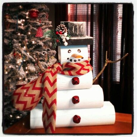 DIY wooden snowman. Landscape timber from Lowes, paint, and some craft scraps. Total cost...about $5.00