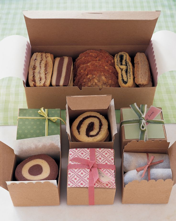 Cookie Boxes Valentine's Ideas | Martha Stewart Living - Wrapping for Valentine's Day doesn't have to be a frilly affair. Add a personal touch to standard white or brown paper boxes by placing your cookies in individual cupcake holders and tying them up with bright lengths of ribbon.