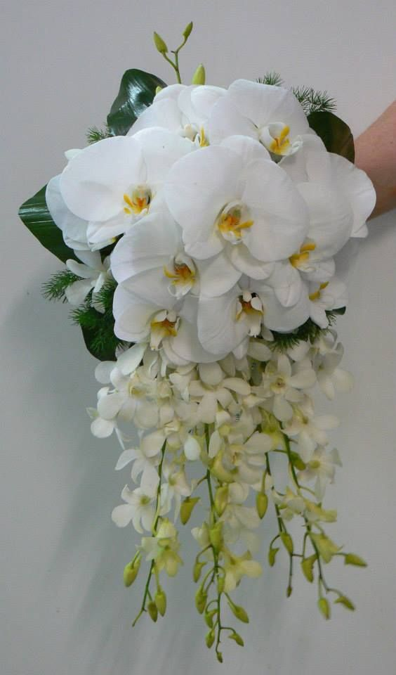 Phalaenopsis & dendrobium orchids in a cascading bouquet