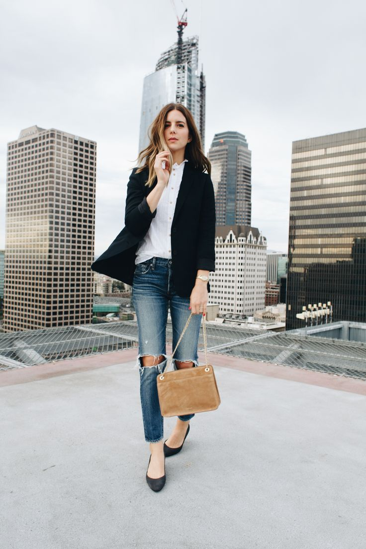 Black blazer, white button down, ripped ankle jeans, camel purse and black flats.