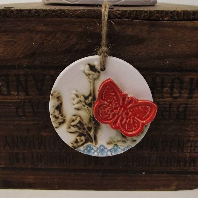 Pottery decoration with natural flower and butterfly motif. £5.00