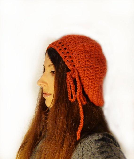 Orange Slouchy crochet hat, wool blend yarn, chunky and warm.    Hand wash in lukewarm water, lay flat to dry.