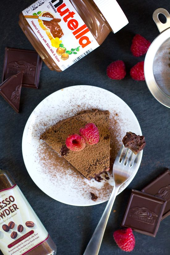 A rich and dense flourless chocolate Nutella cake studded with fresh raspberries. This truffle-like cake is so incredible you'll never miss the flour!