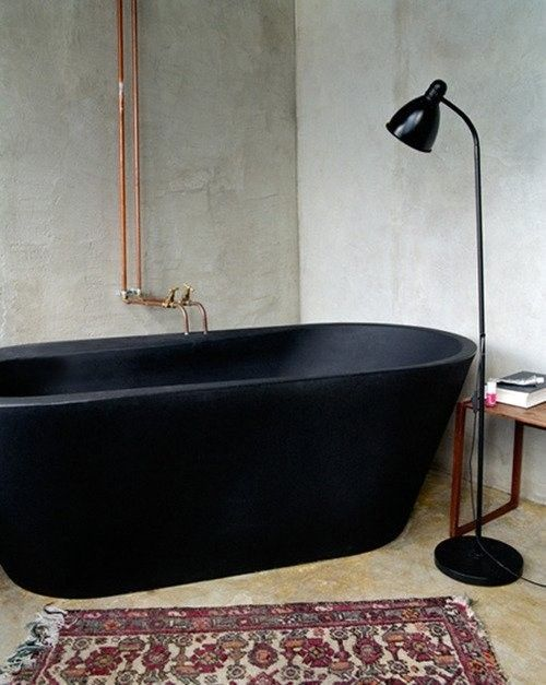 The industrial feel of the copper and the bare walls juxtapose beautifully with the contemporary black tub. Beautiful.