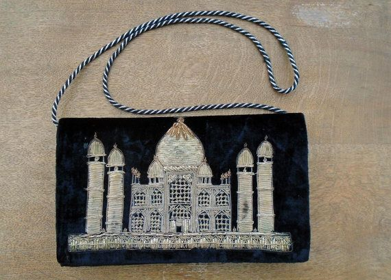 A beautiful vintage black velvet evening bag in excellent condition for its age. This features the famous Taj Mahal embroidered with tiny gold