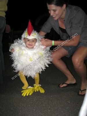 Adorable baby chicken!  Two white feather boas safety-pinned to a onesie...a swimmer's cap cut like a pilot's hat w/ feather glued on...this was all done w/out sewing and is sooo cute...