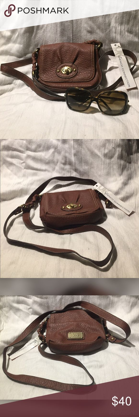 NWT French Connection Brown Cross-body Bag Purse NWT French Connection Brown Cross-body Bag Purse Cute  Found this while doing spring cleaning & it's a cute purse, perfect for a quick outing or a night on the town.  It's simple design w/ the turn turn-lock opening makes this easy to pair w/ jeans or flowery dress.  Take great w/ a pair of sunglasses &  your ready to enjoy the summer days to come.  PLEASE NOTE: Burberry Sunglasses is not included in listing & there is a separate listing for…