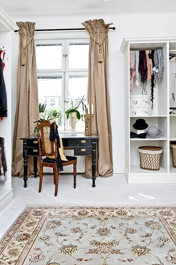curtains and tassels.   http://sussili.se/category.html/sussili-home