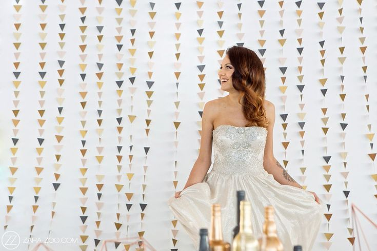 Copper and Grey paper triangle backdrop used as a decor element at a Wedding.