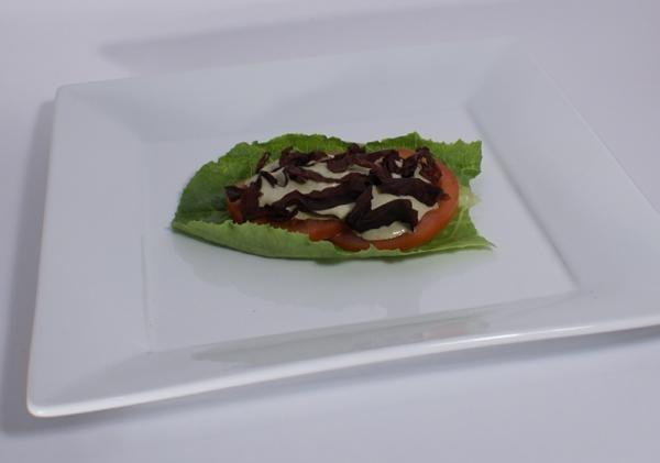 Raw bacon lettuce tomato sandwich.