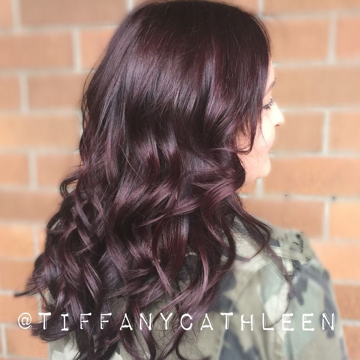 Beautiful rich violet brown hair created with Matrix ColorSync and curled