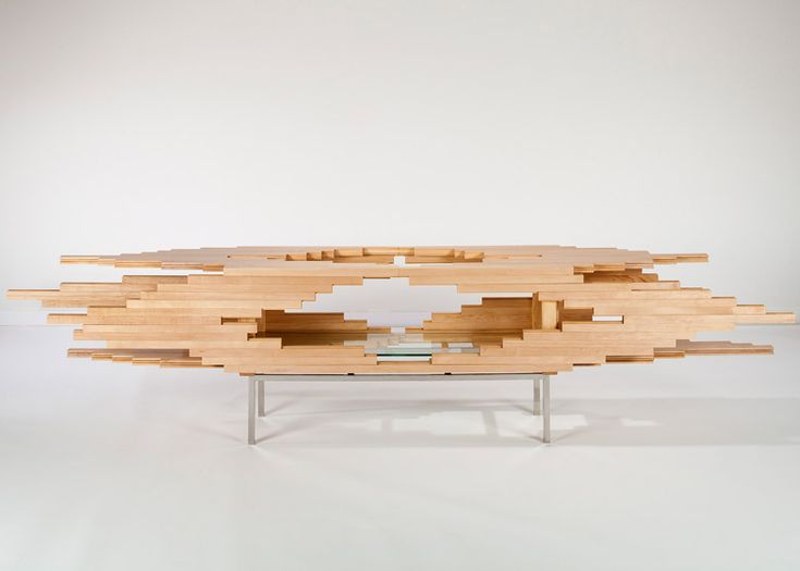 A sculptural wooden cabinet that slides apart to look like it has exploded.
