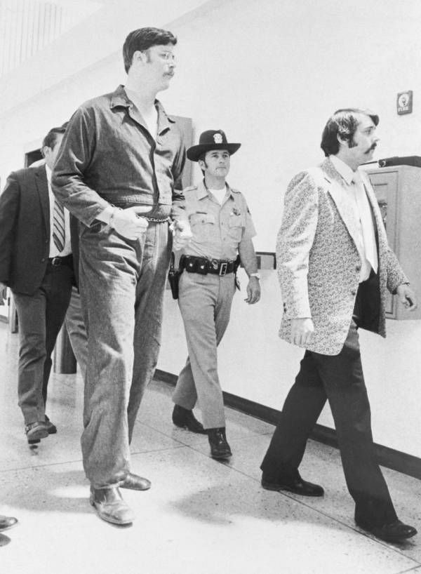 Edmund Kemper, escorted into court by police, was arrested and convicted of 8 counts of first-degree murder. He attempted suicide twice, and requested the death penalty, but was given 7 consecutive life sentences. Kemper was imprisoned at the California Medical Facility alongside Herbert Mullin and Charles Manson, where he still resides to this day. His testimony as to his state of mind during his murders was integral to law enforcement's understanding of the mind of serial killers.