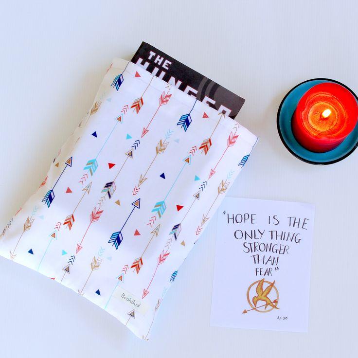 Katniss book sleeve by BookBud. https://www.etsy.com/au/shop/BookBudByGabrielLea?ref=hdr_shop_menu