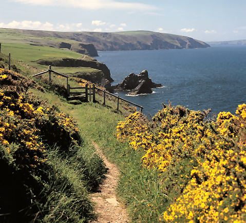 Pembrokeshire Coast Path National Trail, Wales. Rated by Cheap Flights as one of the 10 best hiking trails in the world, this path twists 300 kilometers from St. Dogmaels to Amroth in southwest Wales.  It's often wet and windy, but if you strike lucky on a sunny day this is one of the most beautiful places on earth. Scented gorse and crimson heather brighten the way.