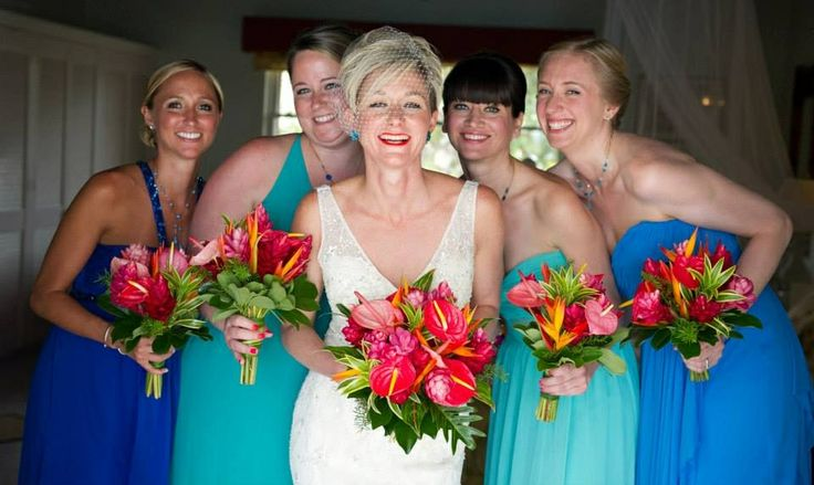 Beautiful bridesmaids!  Love the tropical bouquets. Photography by Mark Bushkes