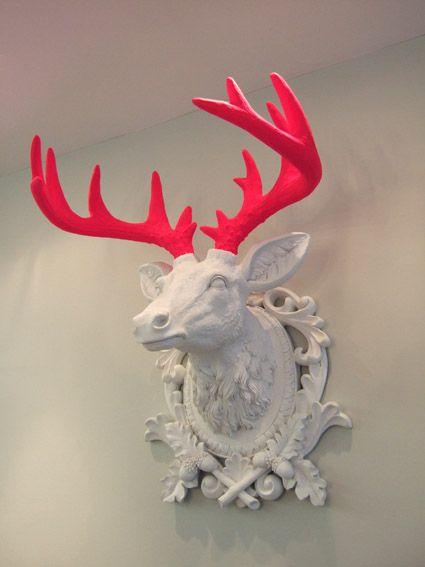 Neon pink antler, Call me crazy, but i kindof love this. Just think of it in the right room with the right furniture...