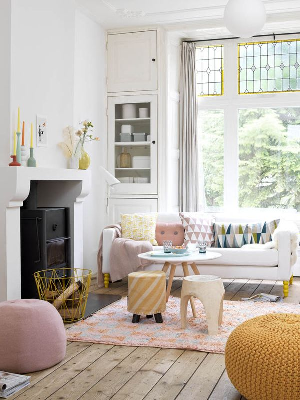 White with a touch of light yellow and pink. Styling by Kim Timmerman. Via Moody's Home.
