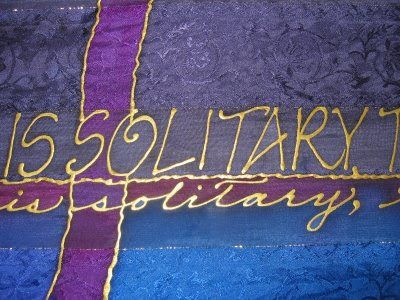 Silks and Art by Jill - gold writing on a brocade design scarf