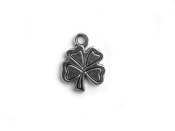 10 silver shamrock charms for jewellery and other crafts. Made of Tibetan Silver, a lead-free alternative to pewter, these charms will not tarnish, and will stay looking like new for decades if cared for correctly.  Hollow backed charm  Overall height 16mm (5/8) approximately.  Dont see what you need? Other quantities and many more charms and other findings in stock. Please enquire! Flat fee shipping. Pay once for shipping no matter how many items you buy.  Canada: $2.95 US: $4.95 Everywhere…