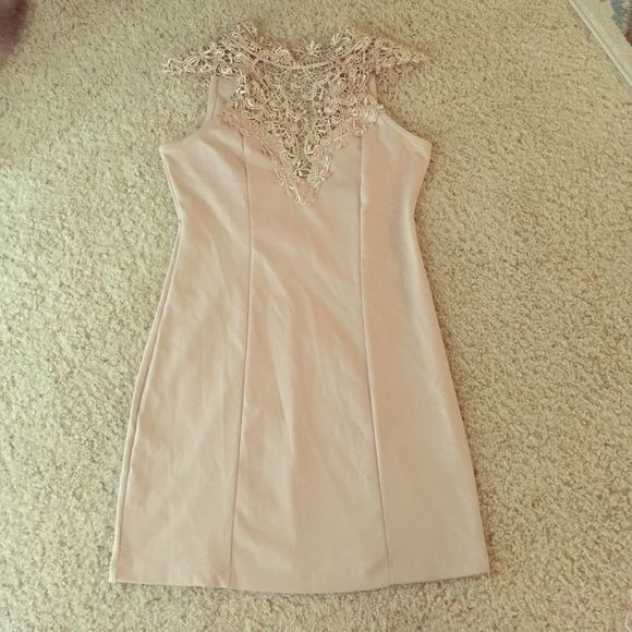 Lacey nude going out dress Gorgeous detail lace around the beck and shoulders. Such a stunning dress. Only worn once Dresses Mini