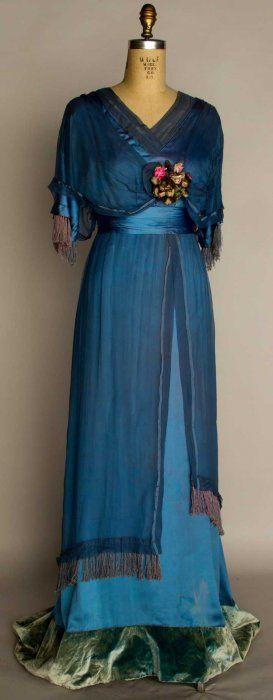 Silk evening gown, 1912 - Powder blue silk satin w/ blue chiffon overdress, ribbon rosette trim, trained skirt w/ velvet hem band.