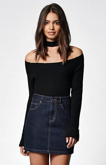 Give 'em a little shoulder in this reimagined sweater by Kendall & Kylie. This off-the-shoulder sweater has soft, ribbed fabric and a separate choker accent. Plus, its black wash complements every bottom in your wardrobe.   	Off-the-shoulder 	Soft, ribbed 	Choker is separate 	Model is wearing a small 	Model's measurements: Height: 5'8.5'' Bust: 32'' Waist: 24.5'' Hips: 34.5''
