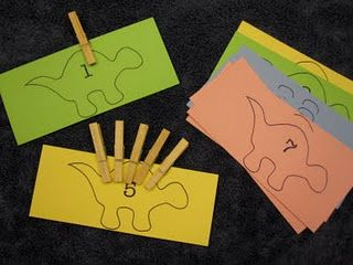 Counting Dino Plates- clothes pins for fine motor and prewriting. Counting, number recognition, math.