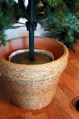 I have always wanted to create a Christmas tree planter.  I love how neat and tidy it makes a tree look, a little unexpected, and of course...