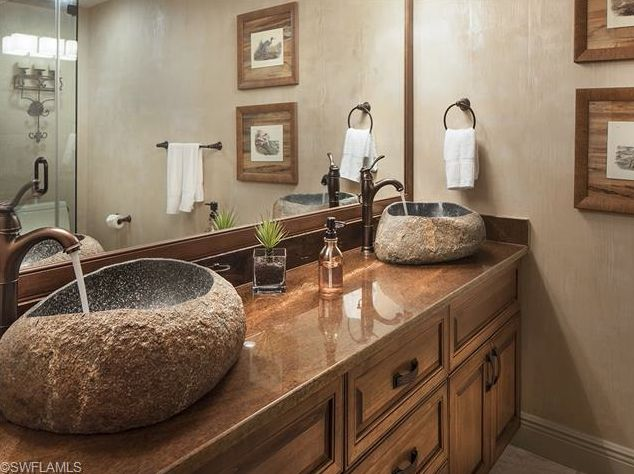 Bathroom with stone bowl sinks.  Renovated Ninth Floor Beach Condo for Sale in Park Plaza   Park Shore   Naples, Florida