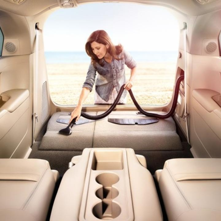 Honda's 2014 Honda Odyssey Minivan features is a built-in vacuum!