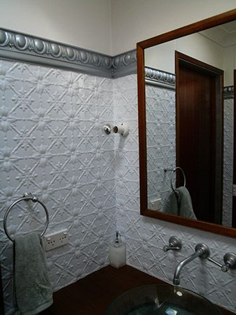 fough tin ceiling in bathroom | pressed tin panels used in a bathroom