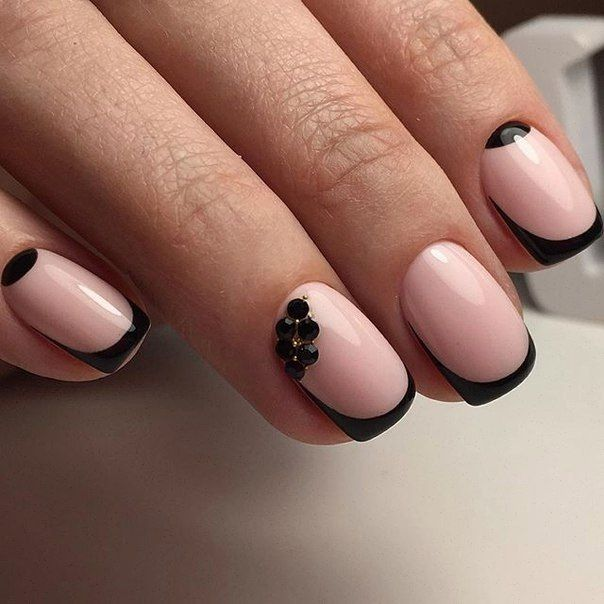 It's enough simple manicure, however, it looks stylish because of using contrasting colours. A milky pink nail polish as a base and a glossy black for maki