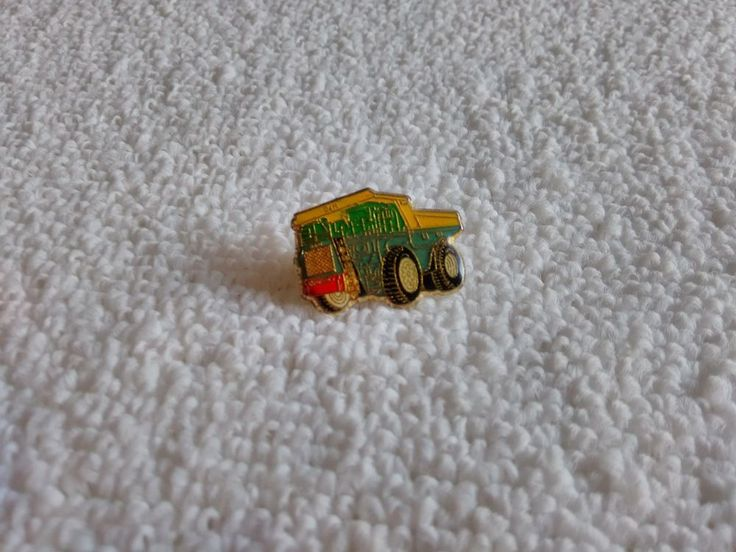 Vintage Dark Mining Truck Company pin badge