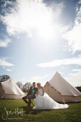 Bride and Groom. Wedding Photography. Summer. Tents and bunting. Glamping.