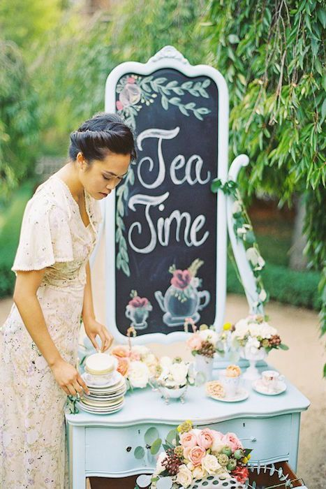 Perfect for a tea themed summer outdoor tea party wedding - decadent treats and fragrant teas served from a delightful painted vintage dresser. Source: brunettesboards.com #teapartywedding #vintageweddings #teatheme