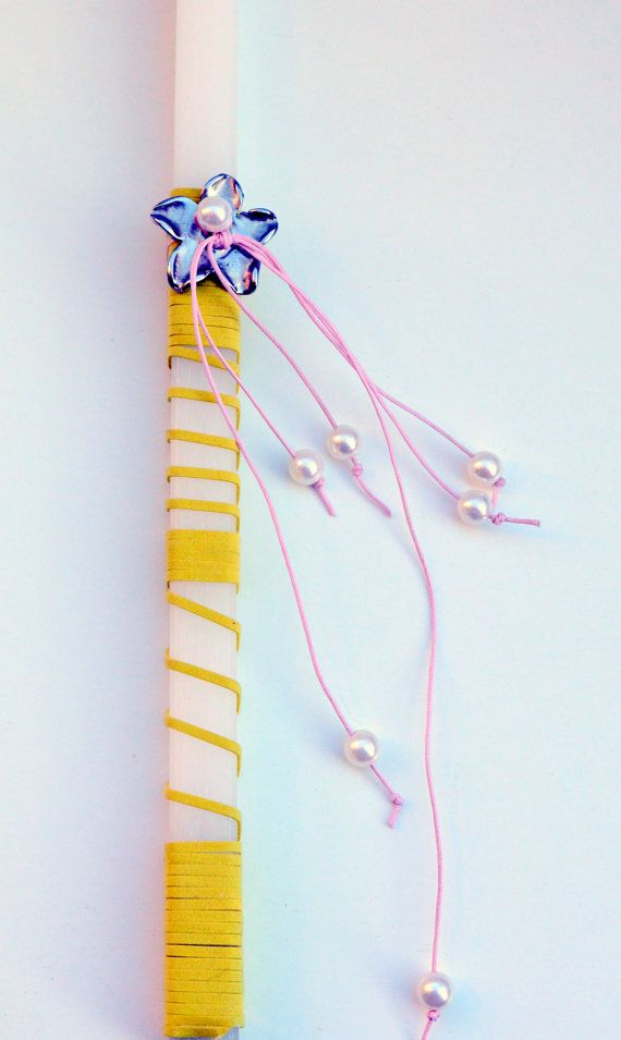 A Greek #Easter square candle in white colour decorated with a suede yellow cord, pearl #beads, pink cord and a metal flower . A beautiful godmother's or godfather's  gift to... #holidays #easter #decoration #lampada #egst #est