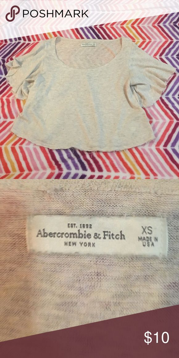 Beige half t-shirt from Abercrombie and Fitch Sexy top from Abercrombie and Fitch. Size extra small. In fair condition. 1 year old. Abercrombie & Fitch Tops Crop Tops