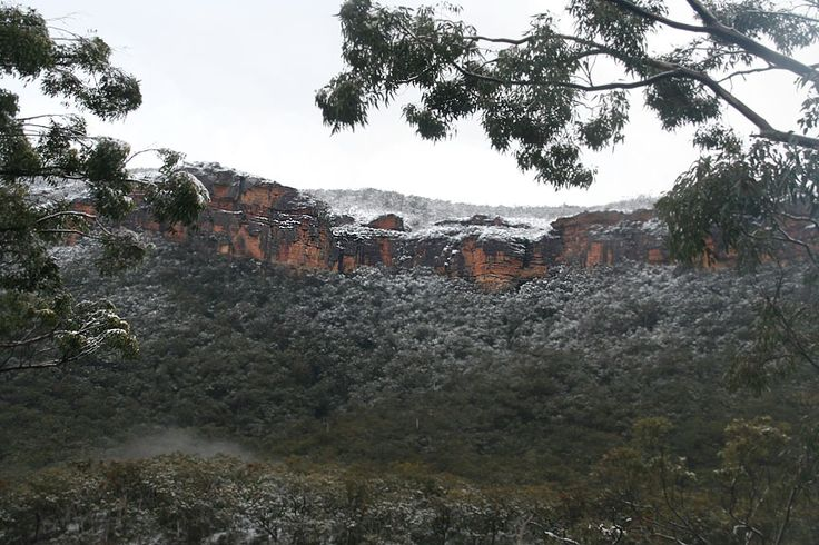 Cliff up close with dusting of snow
