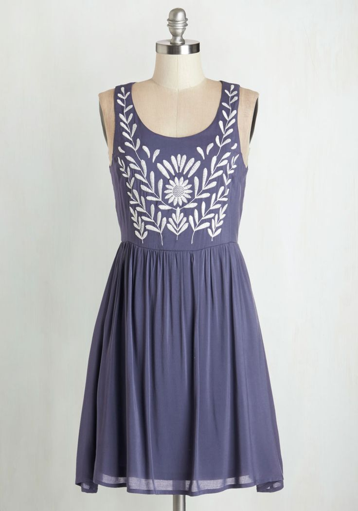 If lovely style is what it's all about, you've got it all figured out in this dusk blue dress! Elegantly embroidered with vines that present a pretty flower, this lined dress is as pleasing to wear as it is for others at the folk festival to admire.