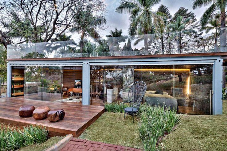 A 320 square feet container home in Belo Horizonte, Brazil. Designed by Cristina Menezes Arquitetura e Decoração.