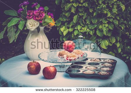Fall still life with flowers, apples and pastry - stock photo