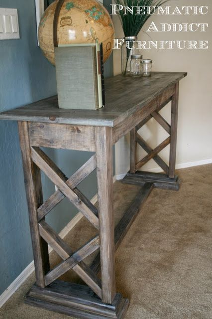Learn to build a Double X Trestle Console table. Tutorial at www.pneumaticaddict.com