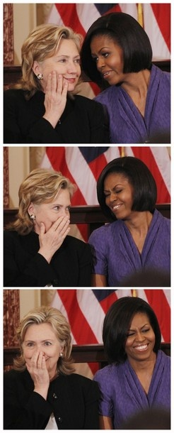 First Lady Michelle Obama and Hillary Clinton at women's rights ceremony.