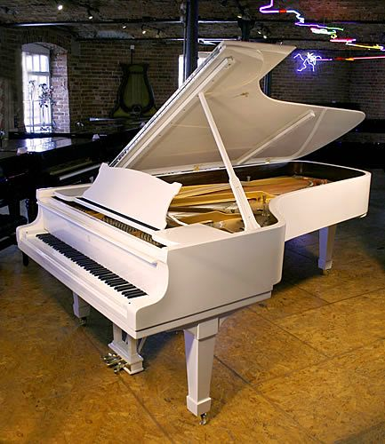 A Steinway Model D concert grand piano with a white case and polyester finish at Besbrode Pianos. This beautiful instrument is the preferred choice of the world's greatest pianists. This white, Steinway Model D grand piano is an unusual finish and would look fantastic on a stage.