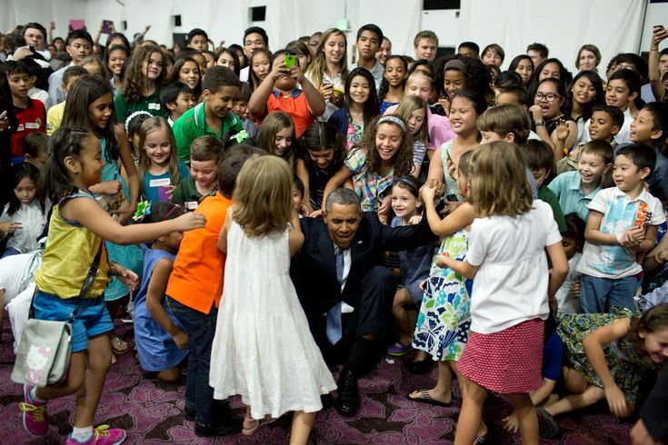 """April 28, 2014 """"'Help me up!', the President beckoned after posing for a photograph with children at the U.S. Embassy in Manila, the Philippines."""""""